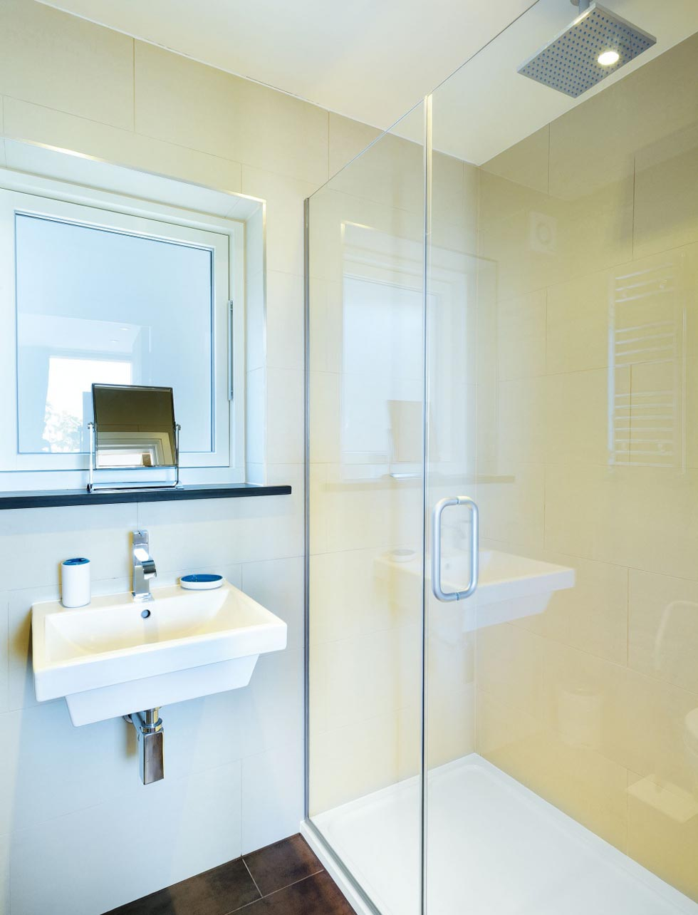 The two en suite bathrooms in the chalet are fitted out with porcelain tiles and sanitaryware from Bathstore