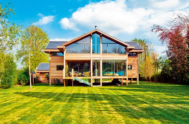 A home built on a floodplain by the River Thames which is built on timber posts
