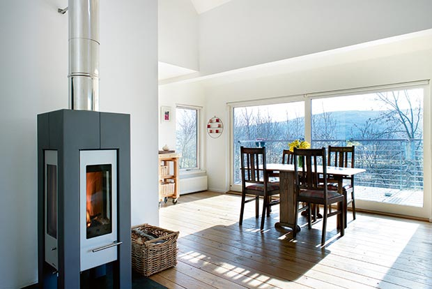 Woodburning stove in the lounge of a woodland home with amazing views of Perthshire