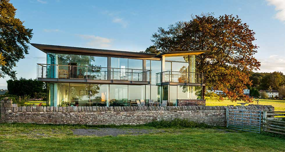 Glazed south facing rear elevation of a contemporary self build house
