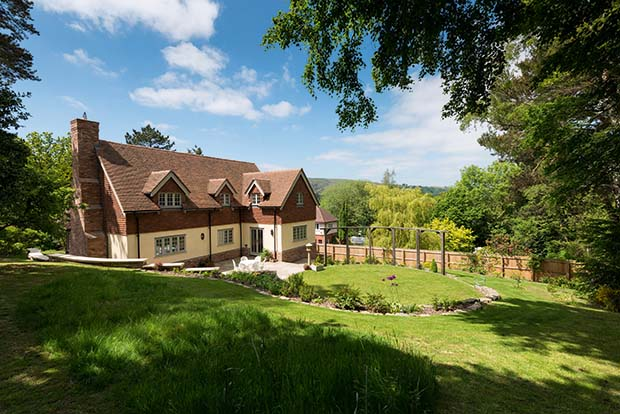 Sloping site home in Shropshire with three storeys and a large landscaped garden