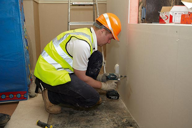adding 69.5mm of Kingspan Kooltherm K14 insulated plasterboard to a solid brick walls