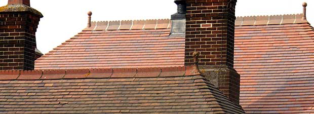 Old and new roof tiles sitting together with tiles from Dreadnought in new brown antique