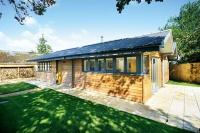An off-mains woodland home