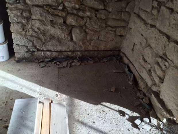 Undercutting the stone wall