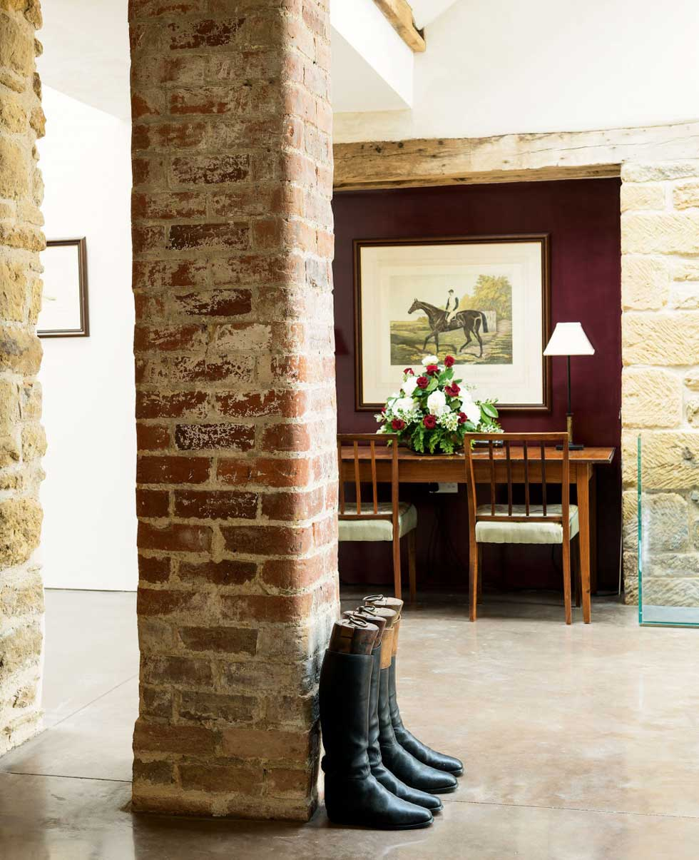 An exposed brick pillar in the open plan dining hall