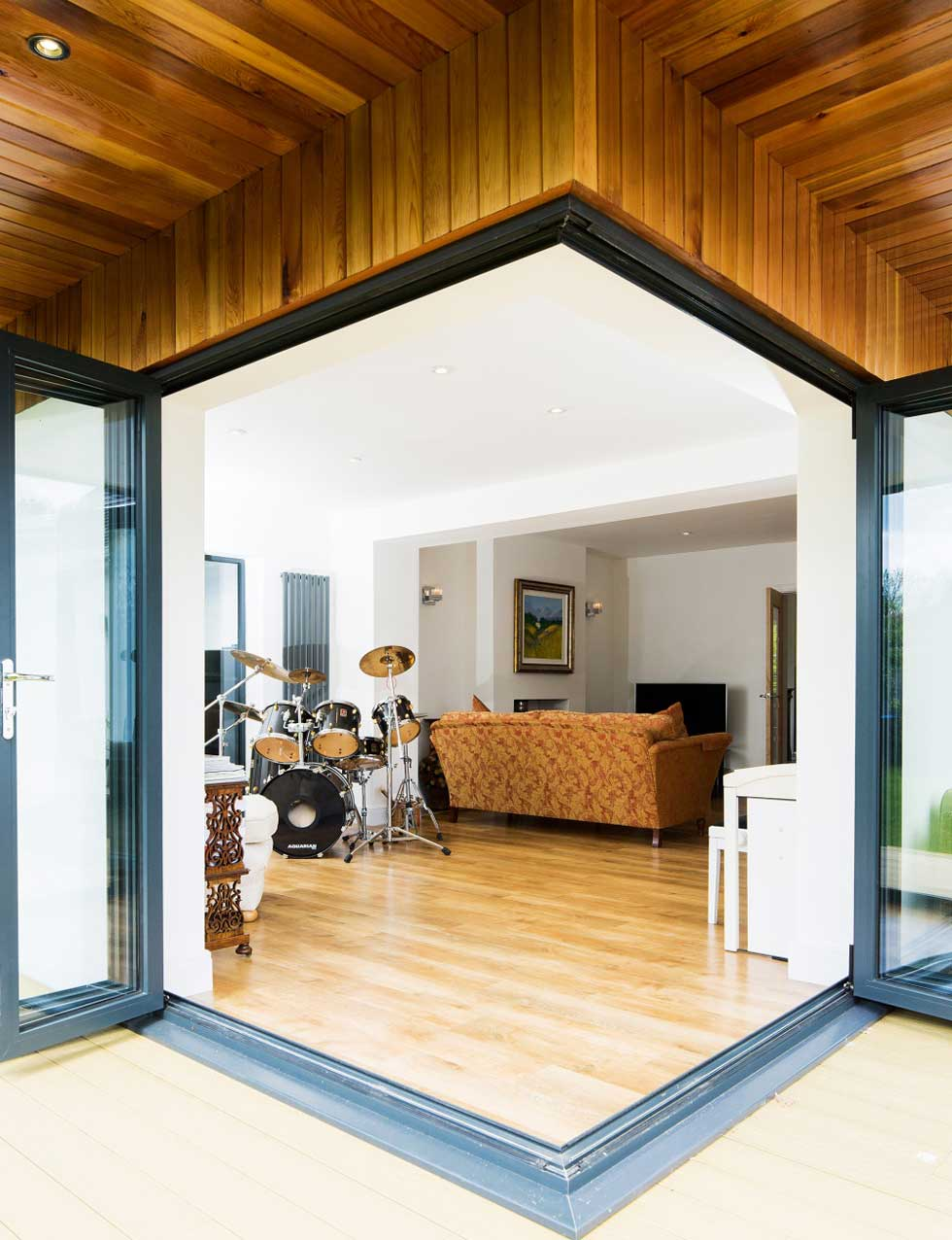 Glazed doors lead into the music room