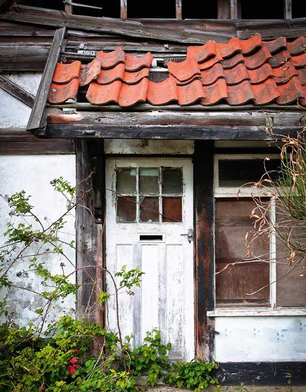 A decaying timber door and door frame
