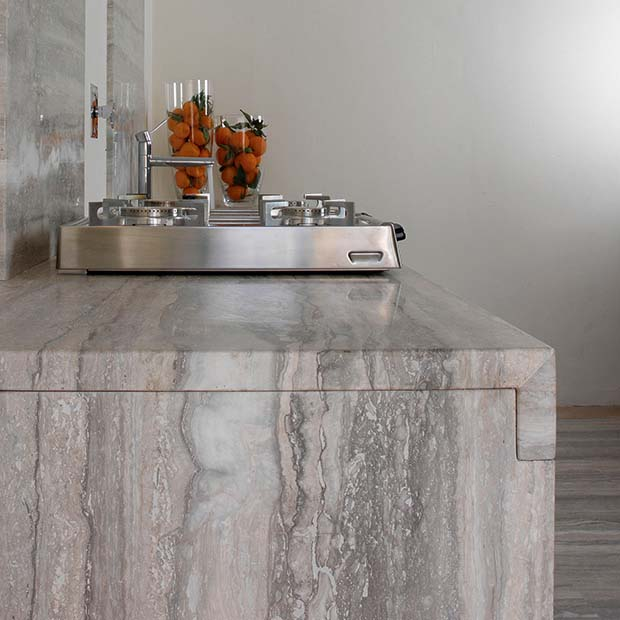 Silver Vein polished worktop with travertine work surface