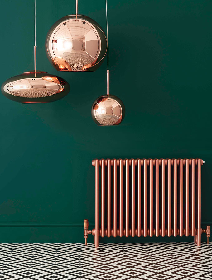 copper radiator in green room with lights contemporary