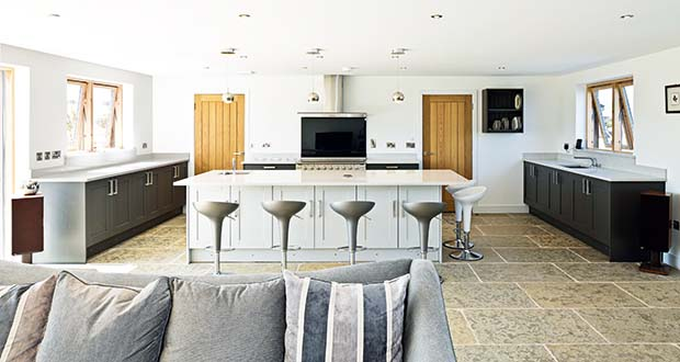 Open plan kitchen in a barn style clad SIPs home