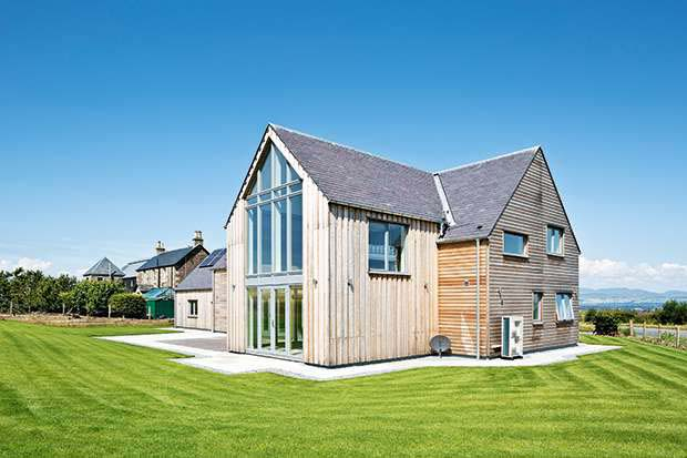 Siberian larch clad SIPs home with double height windows