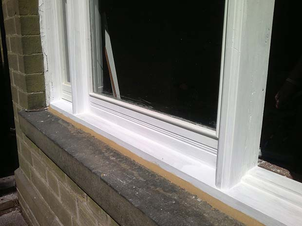 repaired window primed and ready for decorating