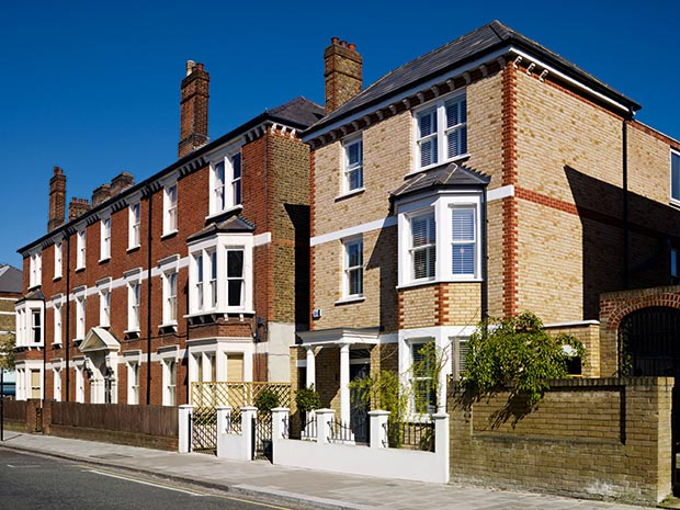 Exterior of a new build home at the end of a row of Victorian terraces in London