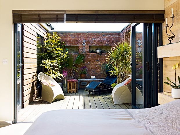 Roof terrace next to a bedroom in a five bedroom Victorian style self build