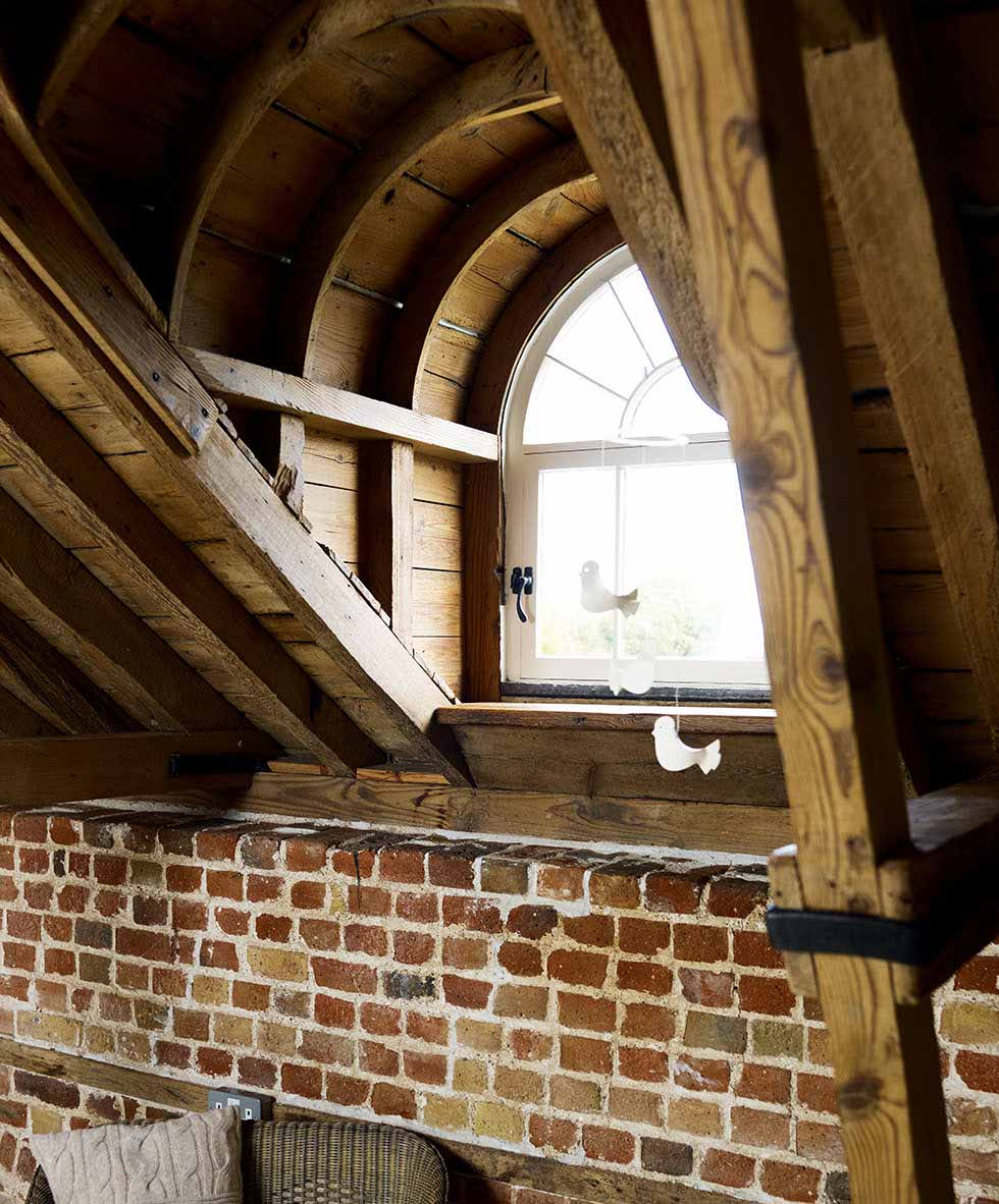 A wooden-arched dormer window