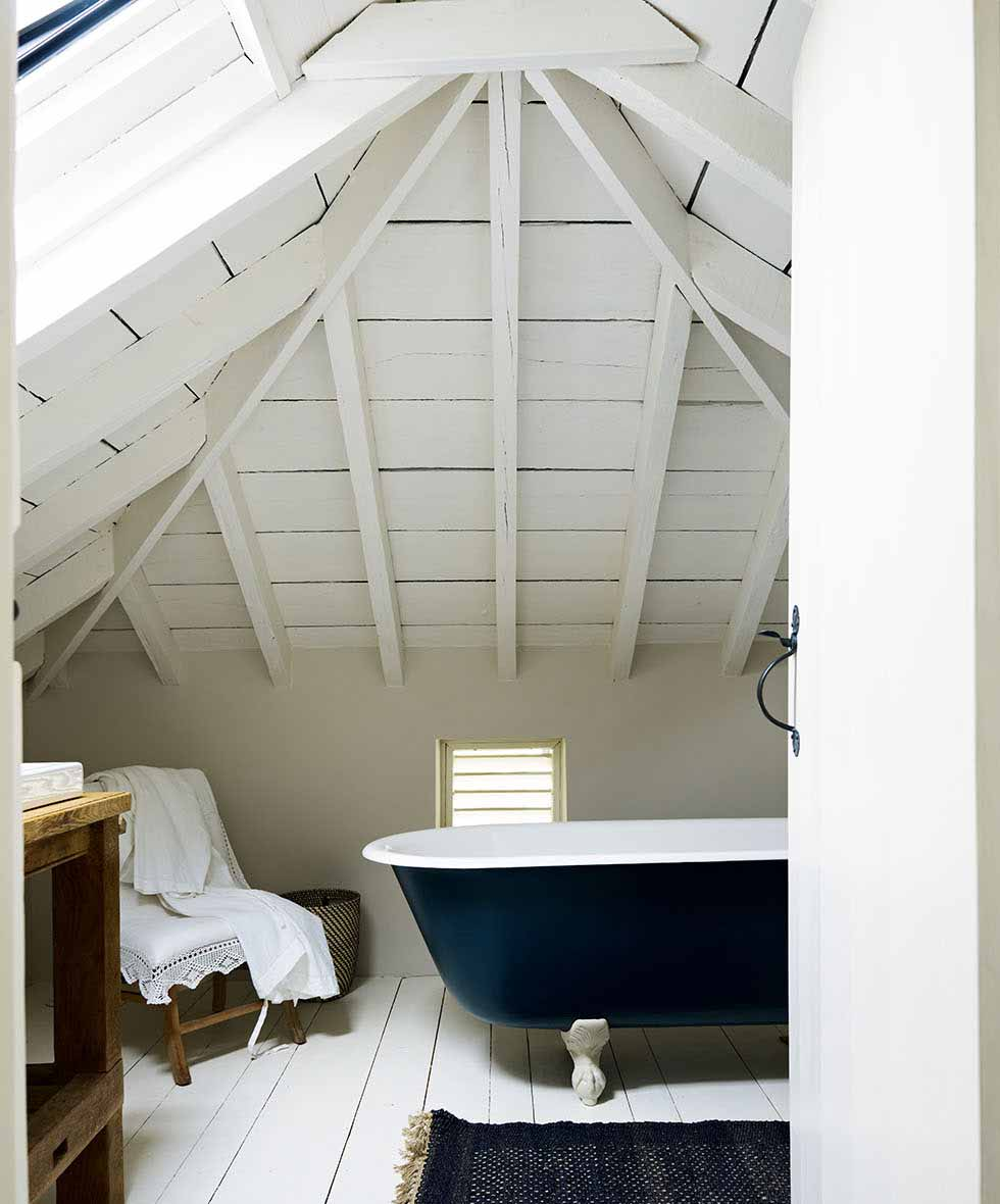 The white painted bathroom in the loft space