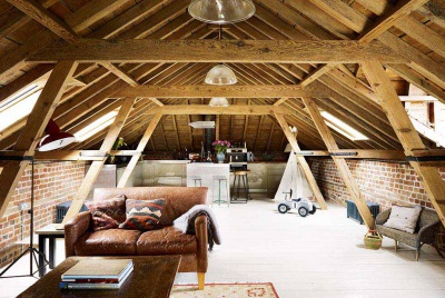 Loft style exposed beam converted roof space in stable