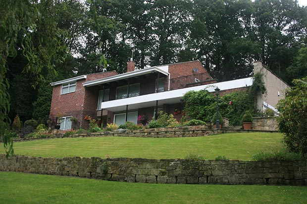 the 1960s hunting lodge style home before it was converted