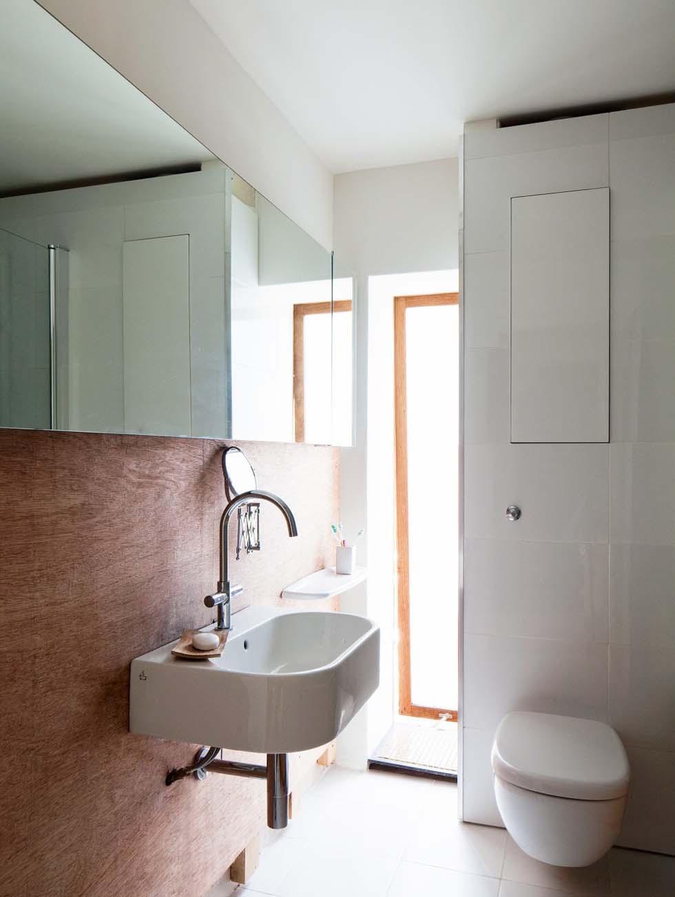 Frosted slot windows in the bathroom draw in plenty of light but offer maximum privacy