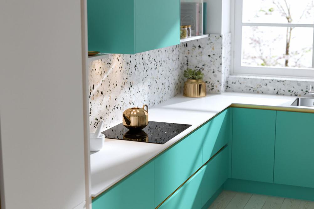 Sleek handleless kitchen mint green