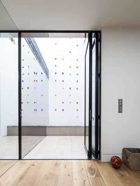 climbing wall from basement in a London home