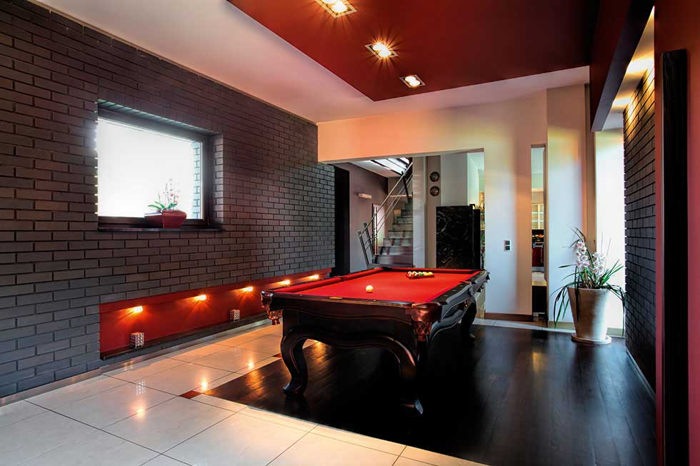 games room with red walls and snooker table