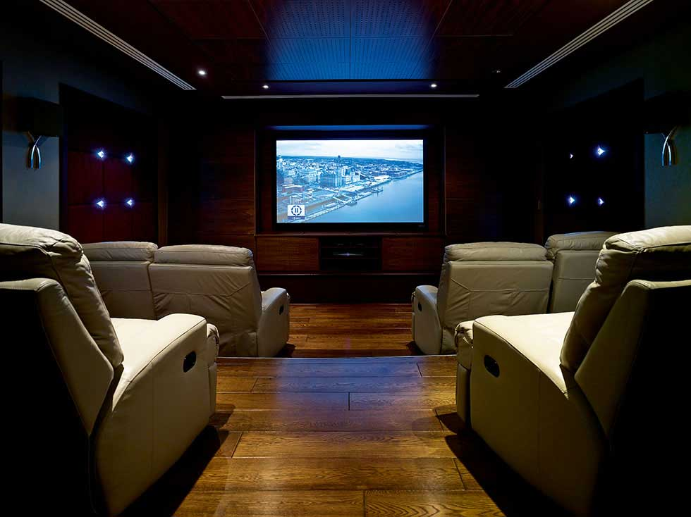 media room with staggered cinema seating and cinema screen