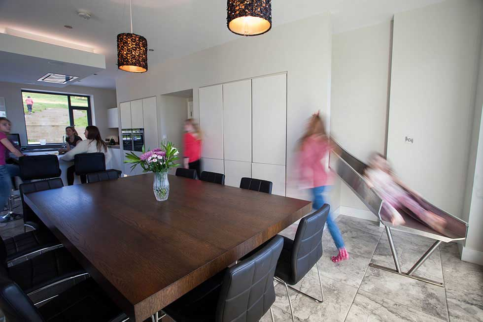 slide into an open plan kitchen in a family home in Ireland
