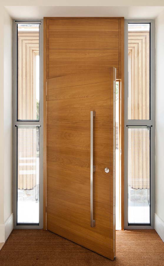 An oversized entrance door by Urban Front
