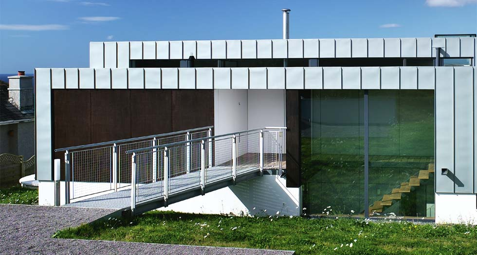 A bridged entrance on a sloping-site home