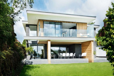 A timber clad contemporary self build with balcony