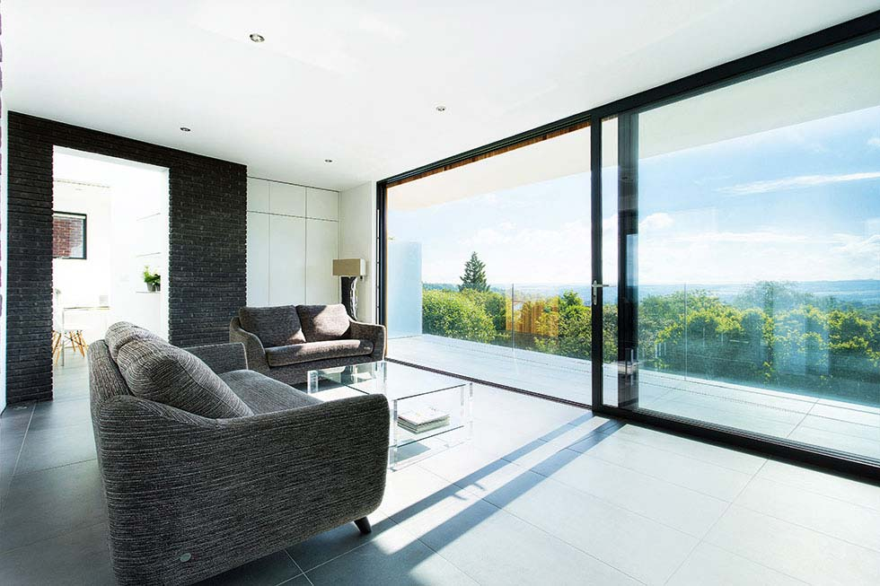 The first floor living room opens onto a balcony through sliding glass doors