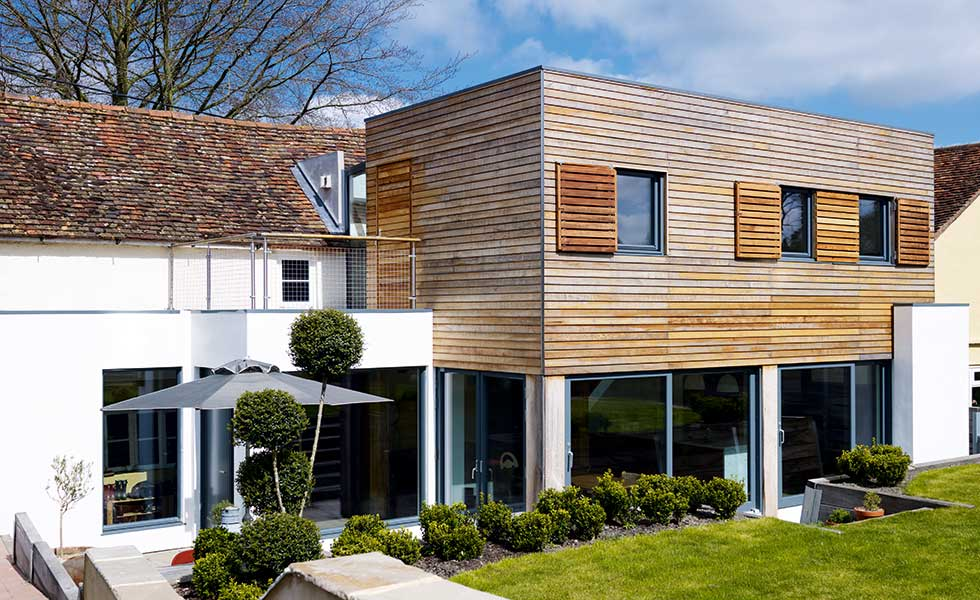 A contemporary timber and render extension has been added to a period home
