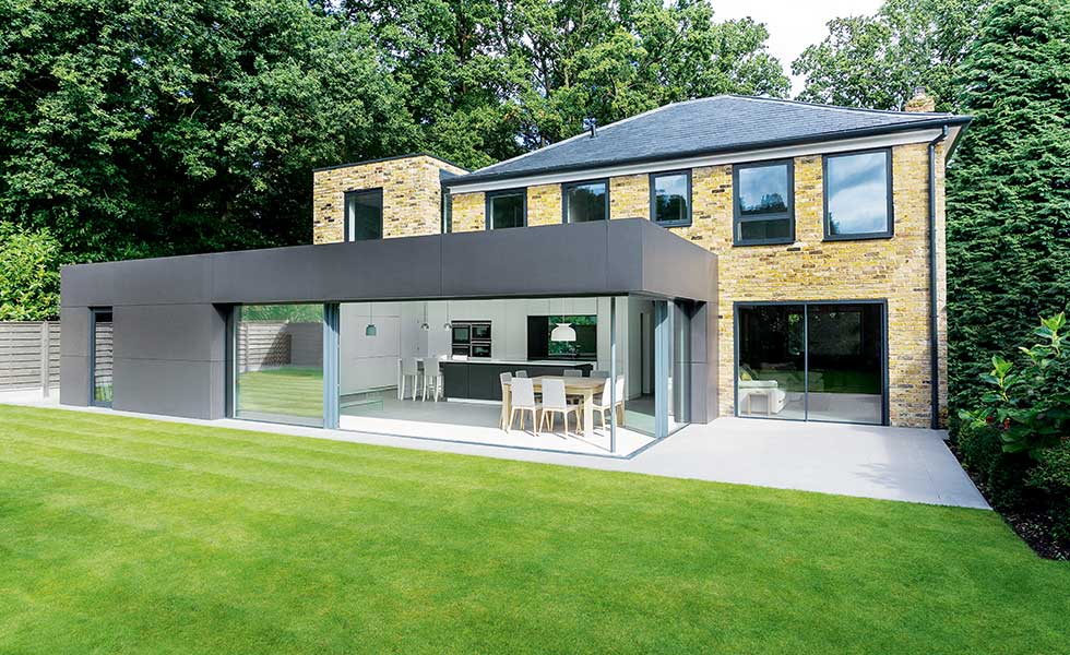 A grey fibre board cement clad extension in Hamsphire by AR Design Studio