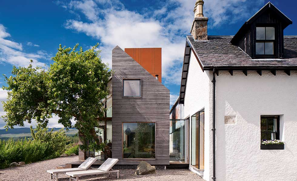 A series of contemporary extensions have been added to this farmhouse