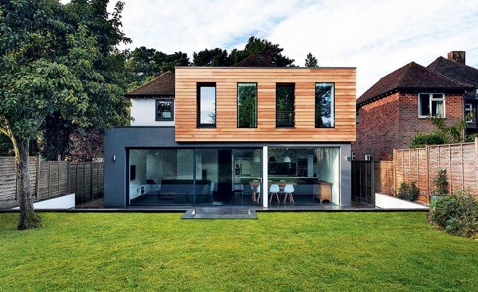 Grey rendered and timber clad extensions by AR Design Studio