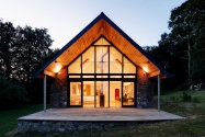 The front of the remodelled bungalow with full-height glazing