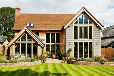 An oak frame home with full-height glazing