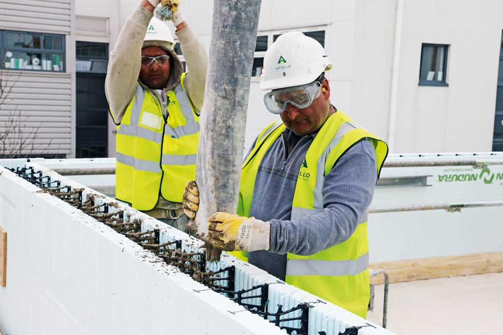 builders filling ICF EPS cavity with concrete