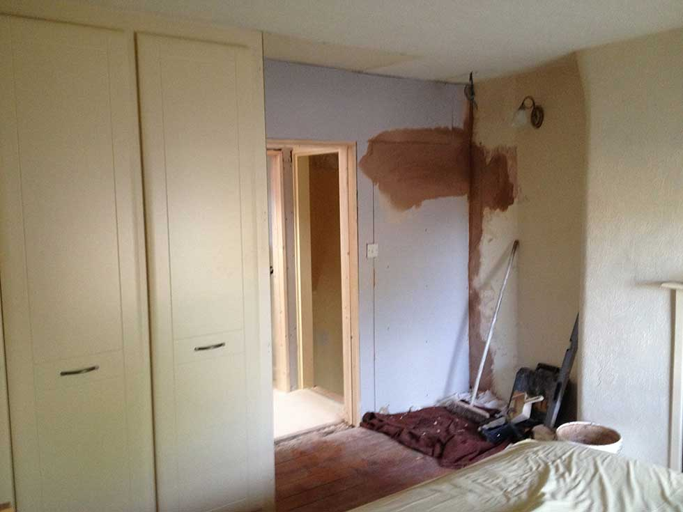 old doorway blocked up and wardrobes moved