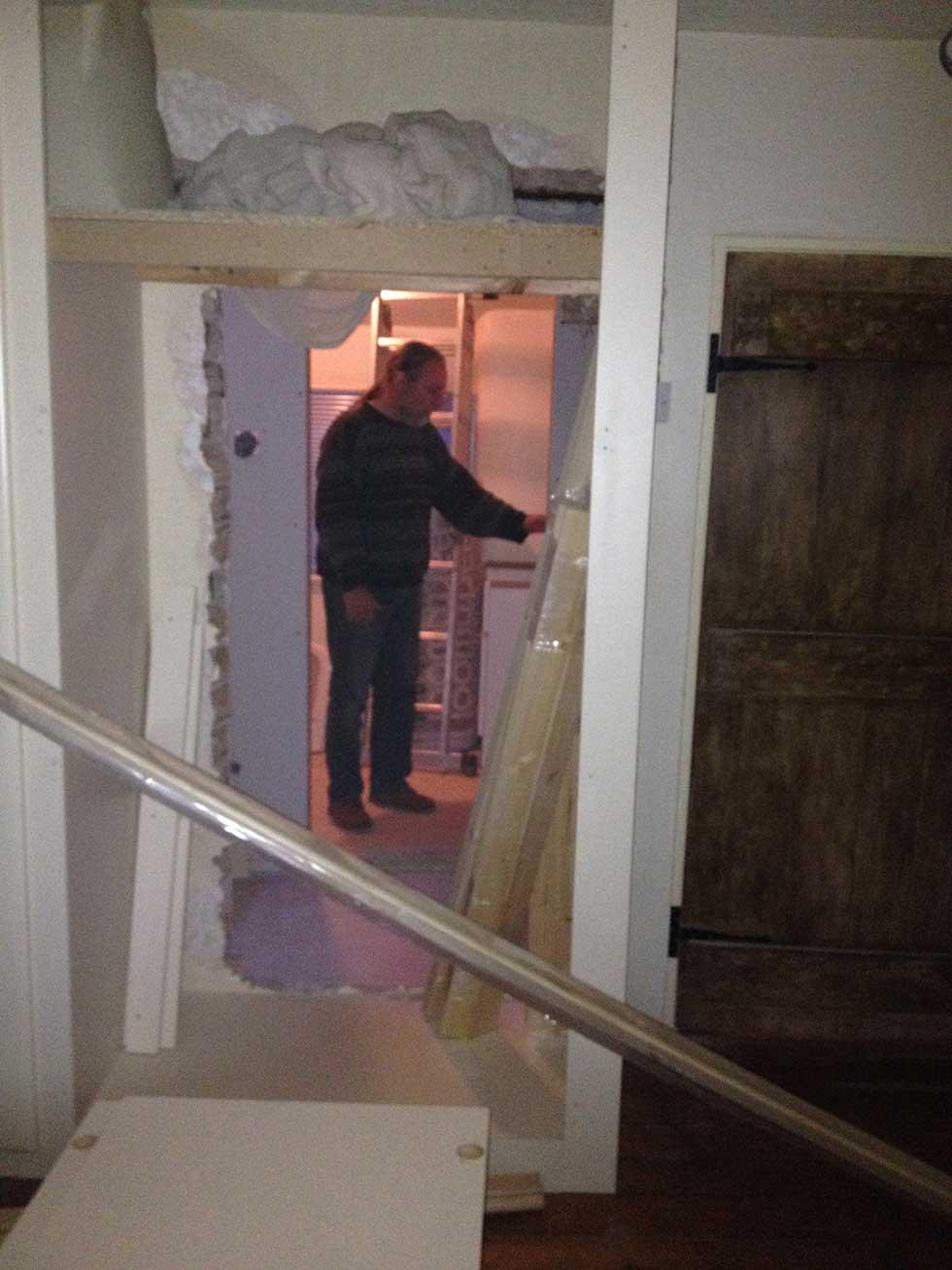 dad in bathroom new door through wardrobe