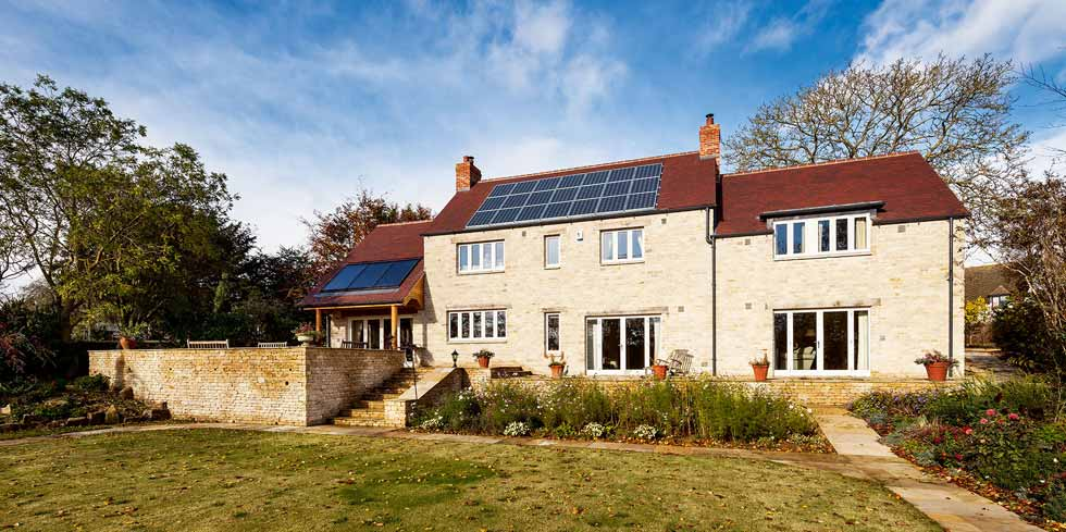 a stone built self build with solar panels
