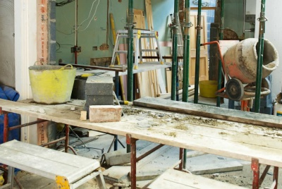 a pasters tables and knocking through walls while renovating