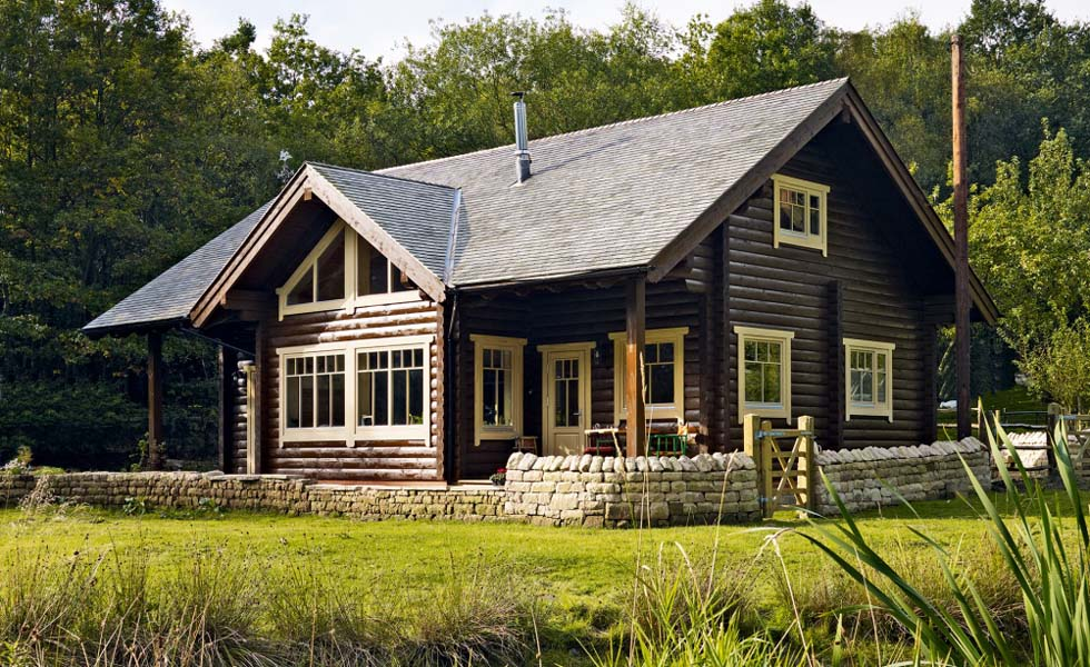 log cabin home on off mains heating