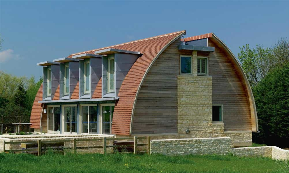 architecturally significant eco home green clad curved roof