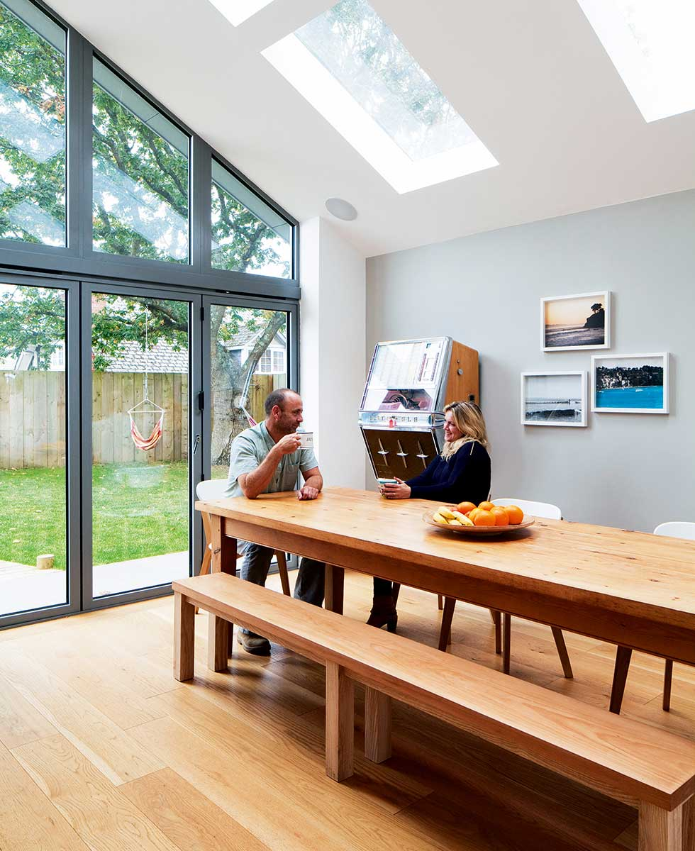 Bi-fold doors open up from the dining area into the garden