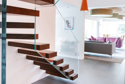 cantilevered dark wood staircase by Bisca