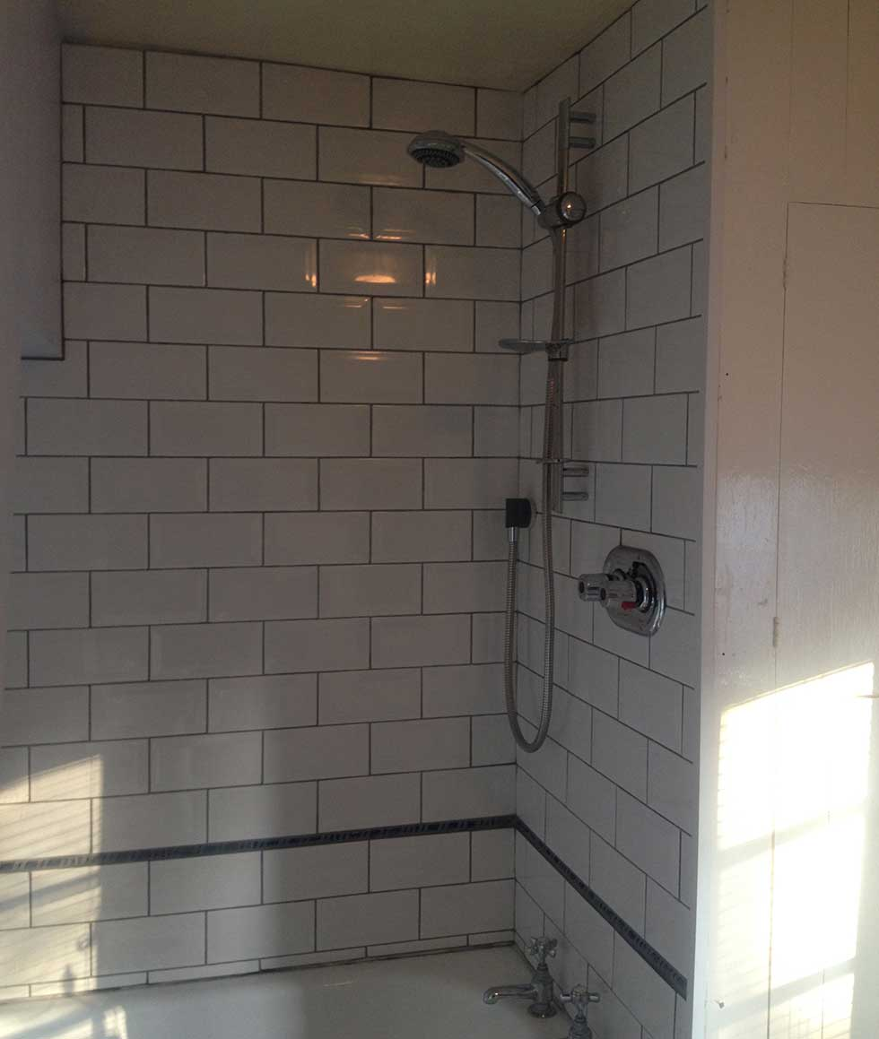Tiled and grouted shower walls