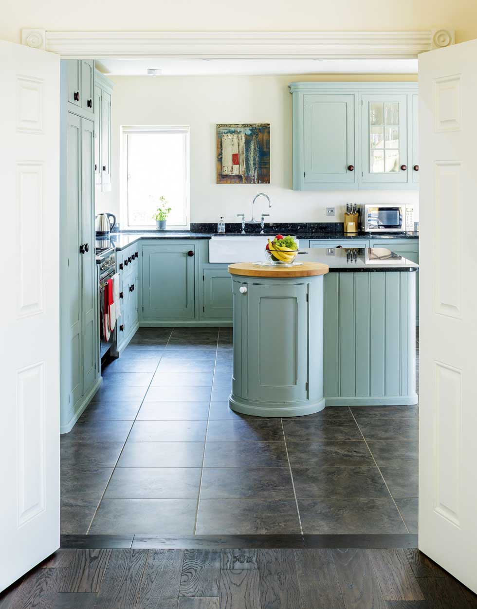 The bespoke shaker-style kitchen includes a centre island